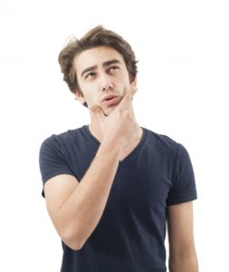 man thinking with hand on chin