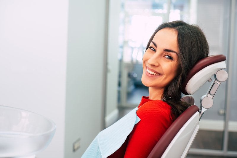 Smiling woman in dentist's chair