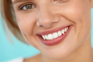 Woman with cosmetically improved smile