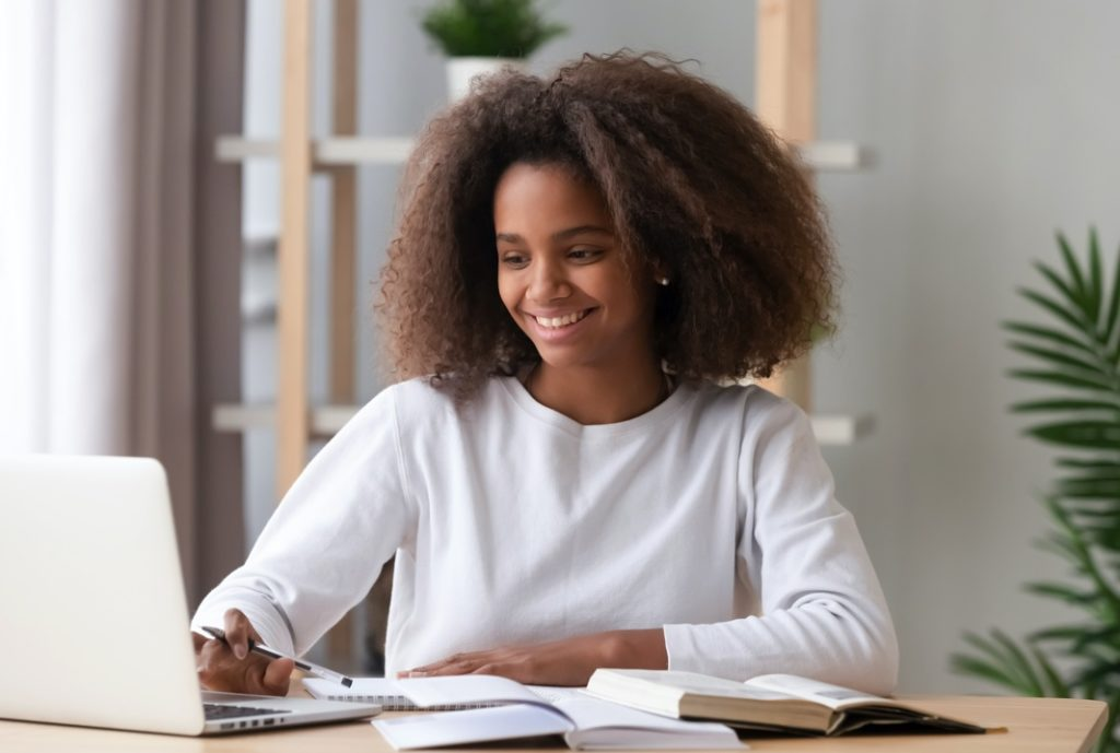 Girl smiling while doing homework